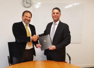Tarik Al Junaidi and Mike Muller after signing the COA agreement