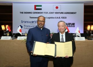 Ramesh S. Ramakrishnan and Takahiro Suzue sign the joint venture agreement