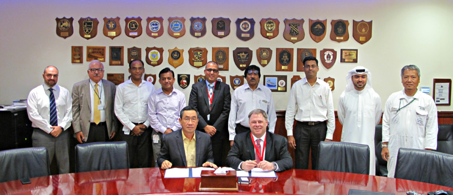 Terry McGowan, President and CEO, Thordon Bearings (seated right), and Mohammad Rizal (left), Chief Operating Officer of Drydocks World-Dubai, sign an agreement that affirms the two companies' efforts to convert ships to seawater lubricated propeller shaft lines from oil