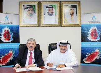 Khamis Juma Buamim and Professor Mustafa Masad signing the MOU following a meeting in Dubai.