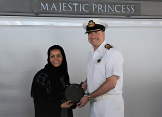 Noura Rashid Al Dhaheri, cruise terminal manager, ADP, presents the captain of Majestic Princess with a special plaque to mark its maiden voyage