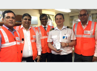 The Captain of CMA-CGM Virginia receiving a memento of the maiden call into APM Terminals Mumbai