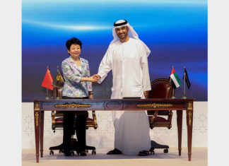 H.E. Dr. Sultan Ahmed Al Jaber, Abu Dhabi Minister of State, and Madame Huang Lixin, Executive Vice Governor of Jiangsu Provincial People's Government, sign the investment agreement