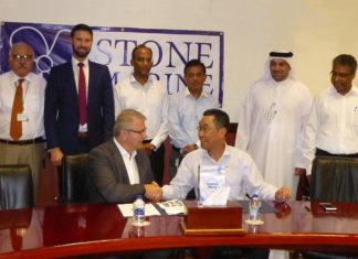 DDW Chief Operations Officer, Mohammad Rizal shaking hands with Don Quilliam, Managing Director of Stone Marine Shipcare, with senior executives from both company's looking on.