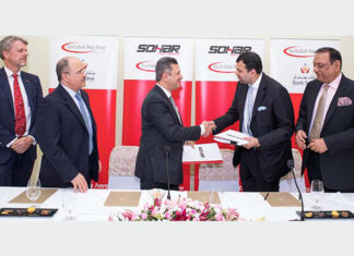 Executives from Sohar Port and Freezone and ShriVallabh Pittie Group signing the land lease MOU