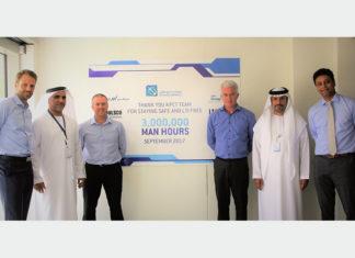 ADT executives Ole Pugholm, Ahmed Al Mutawa, Michael Anderson, Martijn Van De Linde, Saif Al Mazrooei, and Venkat Pisipaty celebrate the 3 million hours without LTI milestone