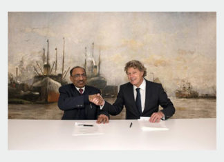 Captain Mousa Murad and Koen Overtoom shaking hands after signing the MOU between the two organisations