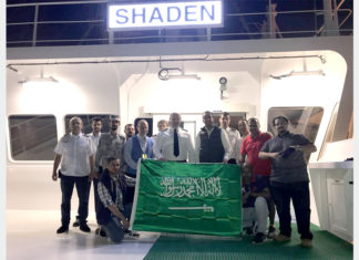The crew of Shaden celebrating the awarding of national flag status to the vessel