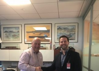 Phil Davies, left, general manager, marine transportation, Chevron Shipping Company, congratulates Lars Hardeland, managing director of GAC's global hub services on securing the global oil and LNG shipping contract