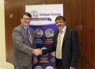 Kongsberg Marine's Konrad Mech shakes hands with Harry Gandhi, chief executive of Unique Group
