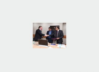 Shri Madhu S Nair, chairman and managing director, CSL, shakes hands with Alexey Rakhmanov, president of USC, in the presence of Shri Nitin Gadkari, Indian shipping minister