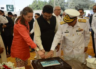 At a cake-cutting ceremony to mark the deliver of the two new vessels, from left to right, Mrs. Ardi Stoios-Braken, the Ambassador of the Embassy of the Kingdom of the Netherlands to the Islamic Republic of Pakistan, Dr. Miftah Ismail, Advisor to the Prime Minister on Finance, Revenue & Economic Affairs and Rear Admiral Syed Hasan Nasir Shah, Managing Director of KSEW