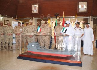 ADSB executives and Kuwaiti Navy staff attend a ceremony to mark the launching of the new landing craft