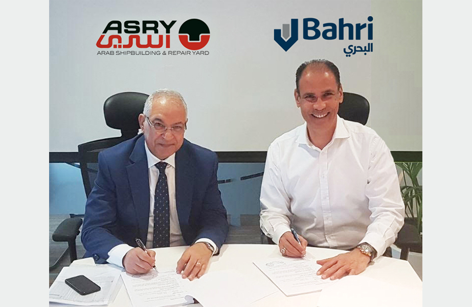 Abdel Aziz Sabri, president, Mideast Ship Management, and Andrew Shaw of ASRY sign the framework agreement for the repair of Bahri's fleet