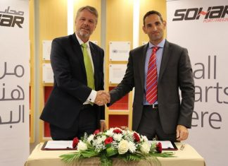 Mark Geilenkirchen, CEO, Sohar Port and Freezone shakes hands with Karim Cordahi, country manager, Svitzer Oman, after signing an agreement for Svitzer to supply and manage two new pilot vessels and provide round-the-clock operational support