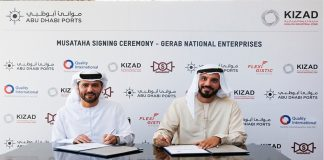 Capt. Mohamed Juma Al Shamisi of Abu Dhabi Ports signing the agreement with Abdullah Sharafi, president, Gerab Group