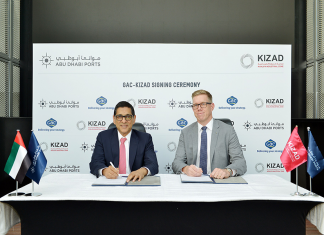 Samir Chaturvedi, Kizad chief executive, and Göran Eriksson, GAC Abu Dhabi managing director, signing the agreement to open warehousing and open yard areas in the free zone