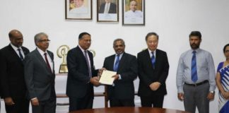 Kavan Ratnayaka, Chairman, SLPA, and D.V. Abeysinghe, Managing Director of Colombo Dockyard, exchanging contracts to build two new pilot boats