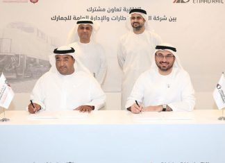 Rashed Lahej Al Mansoori, Director General of the General Administration of Customs in Abu Dhabi, and Shadi Malak, Chief Executive Officer of Etihad Rail, sign the MOU
