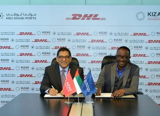 Samira Chaturvedi, chief executive of KIZAD, signing the logistics facility contract with Amadou Diallo, chief executive, DHL Global Forwarding, Middle East and Africa