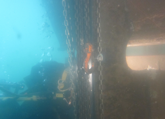 A Hydrex diver performing welding work on the rudder while the vessel was in Jebel Ali