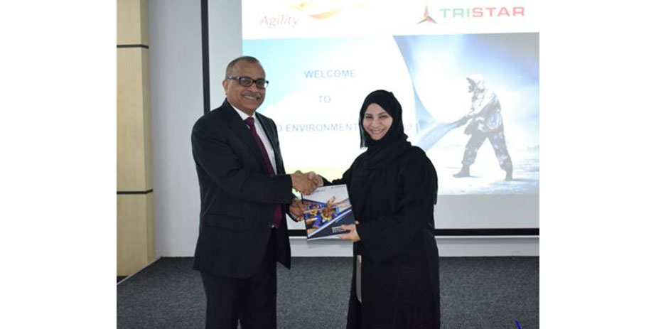 Tristar group Chief Executive, Eugene Mayne, hands over the first copy of the 2019 sustainability report to Emirates Environmental Group chairperson, Habiba Al Marashi