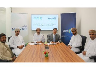 Executives from Marafi and Oman Oil signing the new bunker fuel supply agreement