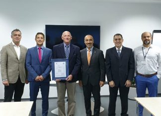 Sohar Port staff receiving the ISPO certificate