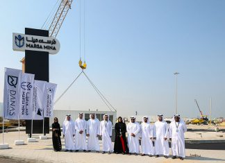 VIPs attend the start of work at Marsa Mina with the debut container in the background