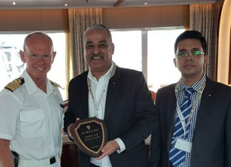 Captain Andrew Peddar, Master of Seabourn Oviation, presents a plaque to Rajesh Moorjani, General Manager of GAC Ras Al Khaimah (middle) and Sathik Ali, Shipping Manager of GAC Ras Al Khaimah (right) during the vessel's call at the new Ras Al Khaimah Cruise Terminal.