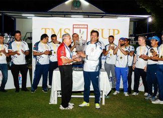 Winning Captain of TMS, Trevor Pereira receiving the TMS Cup from Freddy Sidhwa, Captain of the Rest of Shipping.