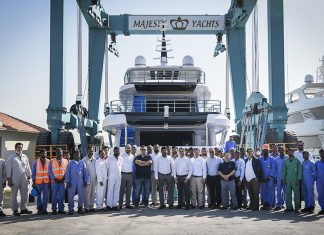 Gulf Craft staff gather in front of the newly launched Majesty 120