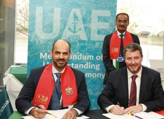 His Excellency Falah Mohammad Al Ahbabi, Chairman of Abu Dhabi Ports, signing the MOU to develop the unmanned tug design with Mike Fitzpatrick, President and CEO of RAL