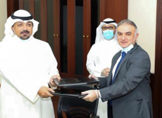 KPA's General Manager Abdulkarim Taqi signing the MoU with PAI Director General Sheikh Yousef Abdullah Al Sabah