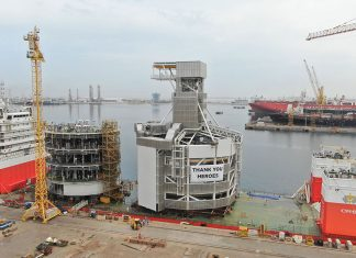 The TMS components being loaded onto a heavy lift vessel prior to departing Drydocks World