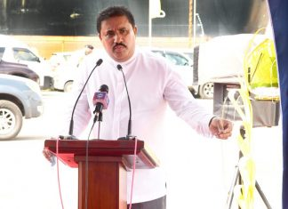 Honourable Rohitha Abeygunawardena, the Minister of Ports and Shipping, speaking at the event to mark the start of construction of the new CFS