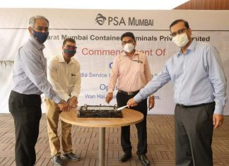 Executives cut a cake to mark the arrival of the first call in the new Wan Hai/Interasia service from PSA Mumbai to the Far East