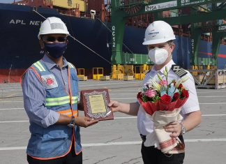 The captain of APL New York receiving a memento and gift to mark the maiden call of the new EPIC service