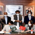 Representatives from Sanmar and Port Qasim Authority sign the contract for six new tugs