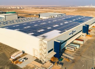 A solar-powered rooftop and a viewing platform were installed 20 m off the ground on GAC's Dubai South contract logistics facility.
