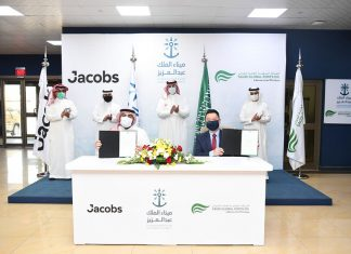 Edward Tah (front, right) and Jacobs's Business Development Director Omar Al Zahrani (front, left) holding the letters of award to appoint Jacobs as SGP's civil engineering consultant. Witnessing the event are SGP's Chairman, Abdulla Al Zamil (rear, right), Mawani President H.E. Omar Hariri (rear, second from right), Jacobs's Market Director, Abdulelah Alsheikh (rear, second from left) and Mawani's Director General for King Abdulaziz Port Hassan Faqeha (rear, left)