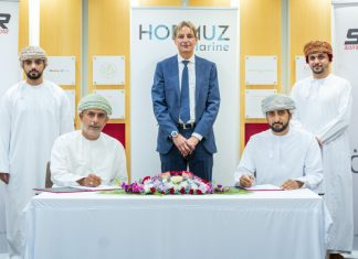 Executives from Sohar Port and Hormuz Marine signing the round-the-clock bunker fuel supply agreement