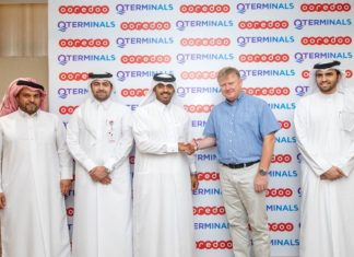 QTerminals and Ooredoo executives marking the completion of Phase 1 of the 5G coverage of Hamad Port's CT 2 facility