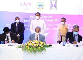 Capt.Nihal Keppetipola and Upul Jayatissa sign the agreement on behalf of Sri Lanka Ports Authority (SLPA), with Capt.Sandeep Mehta and Krishan Balendra of Adani and John Keell Holdings respectively